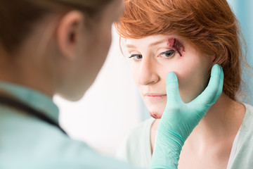 Doctor medicating eye wound