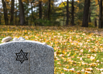 Jewish tradition of commemorating the deceased by placing stones on the grave, symbols of the lasting presence of the deceased's life and memory