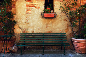 Fototapete - Retro bench outside old Italian house in a small town of Pienza, Italy. Vintage