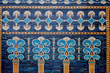 Ceramic coating with images of trees and patterns on the historical wall of Babylon