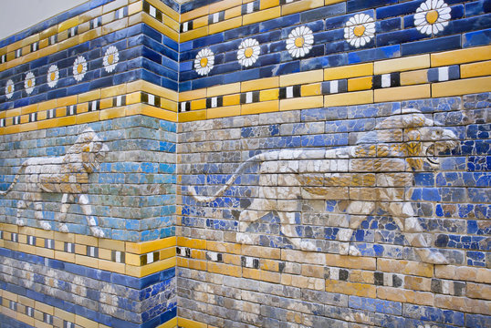 Lions following on the hunt, patterned wall of  the historical city of Babylon