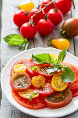 Colorful tomato salad basil