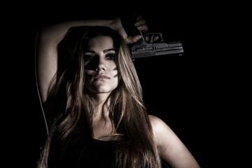 Military woman with a gun
