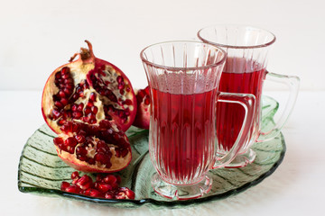 Pomegranatr drink and pomegranate pieces.