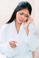 Asian woman taking painkillers for headache