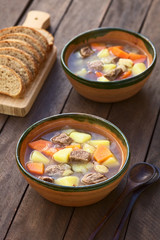Traditional Hungarian soup called Gulyasleves (Goulash soup) made of beef, potato, carrot, onion, csipetke (homemade pasta) (Selective Focus)