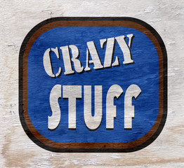 crazy stuff sign on wood texture