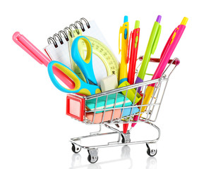 Bright stationery objects in mini supermarket cart isolated on white background