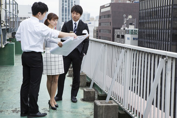 Businessman, has seen the drawing in building rooftop