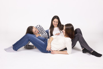 three girls chatting lying on floor. White background