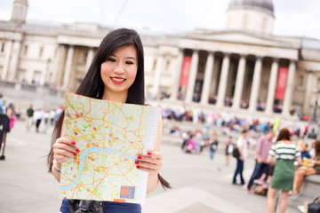 japanese woman in Trafalgar square reading a map