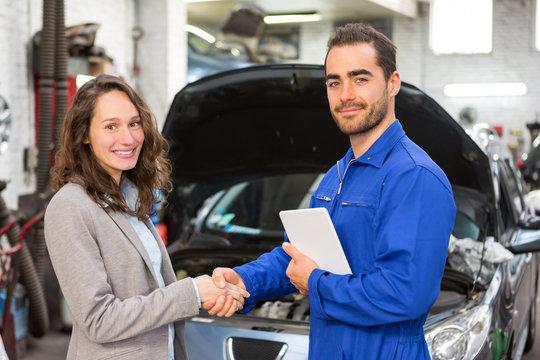Customer and mechanic at the garage