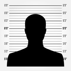 Silhouette of  anonymous man in mugshot or police lineup backgro