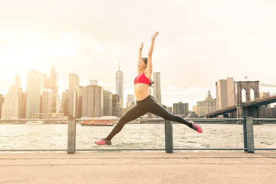 Asian young woman jumping with New York skyline on background