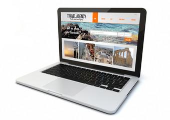 laptop travel agency website on screen