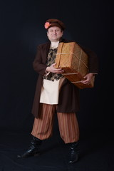 a man in an old suit with a suitcase