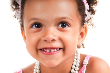 Close-up portrait of mulatto young girl with curly hair. Smiling face. Happy childhood