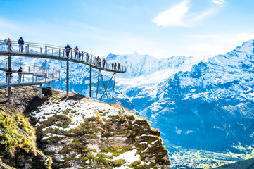 Steel catwalk over snowy Alps round the First top station above Grindelwald, Switzerland.