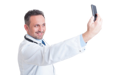 Handsome doctor or medic taking a selfie with front camera