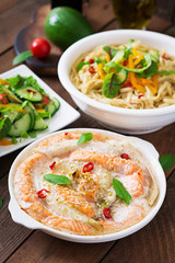 Baked slices of red and white fish with honey and lime juice, served with fresh salad and soft noodles in miso broth.