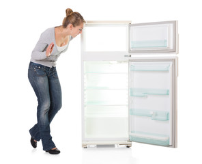 Young Woman Looking At Empty Refrigerator