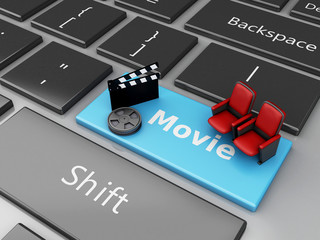 3d Cinema Clapper board and theater seat on computer keyboard.