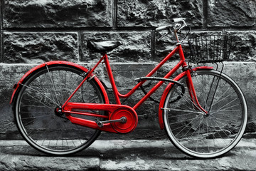 Fototapete - Retro vintage red bike on black and white wall.