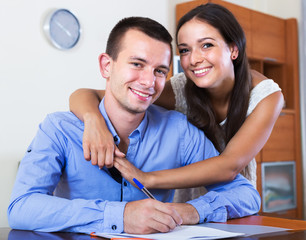 Couple filling marriage application form