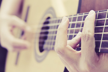 image of Man playing his acoustic guitar Background