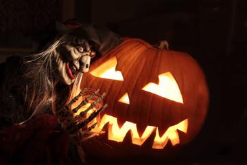 Halloween pumpkin with sorceress