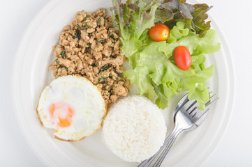 Thai spicy food basil pork with rice and fried egg on top (Krapa
