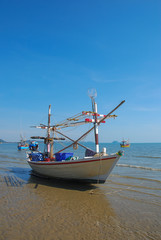 Small fishing boats on the beach in Phetchaburi