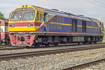 Thai colorful train arriving at station - vintage train