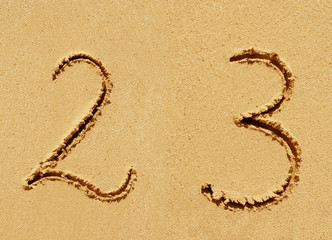 Sand font or number set or collection on an exotic beach near the sea in summer