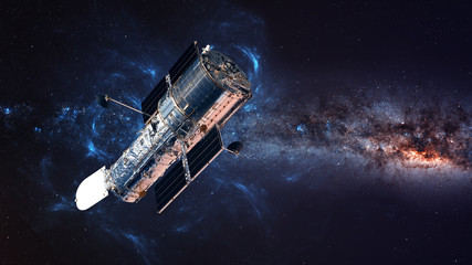 Wall Mural - The Hubble Space Telescope in orbit above the Earth. Elements of this image furnished by NASA