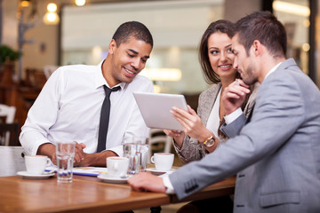 Young businesspeople having a business meeting at coffee shop