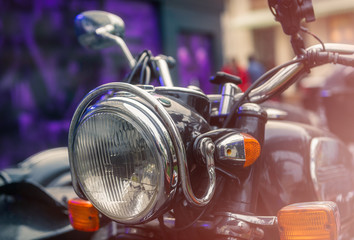 Close up of a headlight of a classic motorcycle, cinema style
