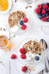 Healthy breakfast. Granola with pumpkin seeds, honey, yogurt, fresh berries .