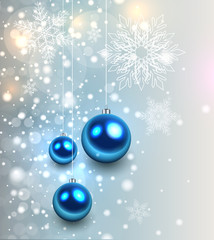 Christmas background with glossy balls and glittering lights