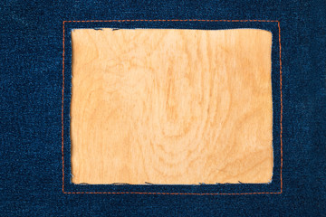 Frame for the text from a dark jeans fabric with the stitched lines of an orange thread