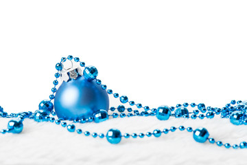 Blue Christmas ball with garland. Copyspace for your greeting or wishes