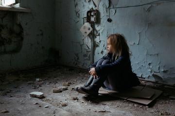 Hopeless girl sitting on the floor  Wall mural