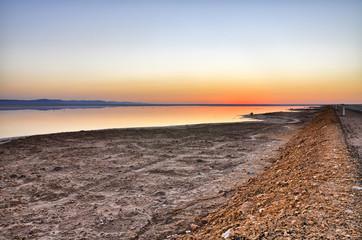 Beautiful sunrise on salt lake Chott el Djerid, Sahara desert, T