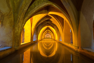 Illuminated ancient baths at the Alcazar in Seville