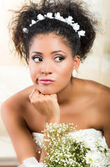 Portrait of beautiful exotic emotional bride looking impatient