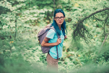 Beautiful hiker girl in summer forest