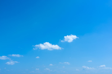 Small white clouds in the blue sky