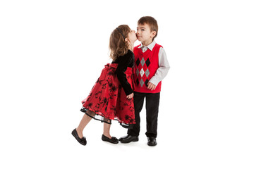 3 year old fraternal boy and girl twins kissing isolated on white