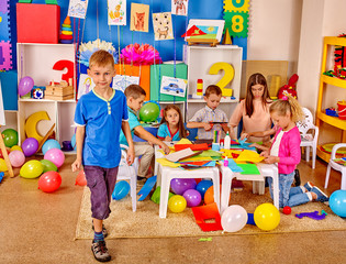 Group kids in preschool interior