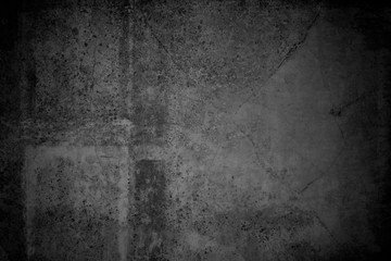 Grunge background texture image. Old abstract vintage black wallpaper. Dirty paper art with scratches and stain. Rough dark aged canvas with dirt and brush lines. Vignette light and shadow effect.